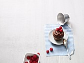 Chocolate and banana cakes with raspberries (Paleo diet)