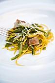 Tagliolini con asparagi, rigatino e pecorino (tagliatelle with asparagus, bacon and Pecorino, Italy)