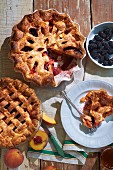 Peach and berry pie with blackberries, raspberries, and apricot jam