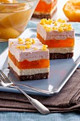 Slices of layered cake with peach jelly