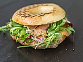 A salmon and salad bagel
