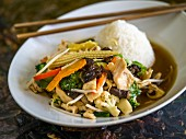 Stir-fried vegetables with chicken and scented rice (Thailand)