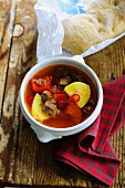 Goulash soup with peppers, chilli and potatoes