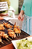 Chicken kebabs on a barbecue