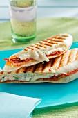 Cheese and salami paninis