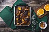 Duck legs with oranges, cranberries and honey
