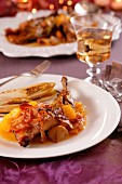 Pheasant wrapped in bacon with orange sauce, chestnuts and chicory