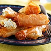 Stuffed filo pastry rolls