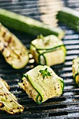 Courgette and goat's cheese parcels on a barbecue