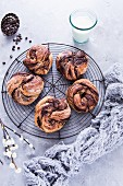 Chocolate pastry swirls on a wire rack