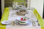 Table set for two with wreath in centre