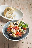 Greek bread salad with vegan almond cheese