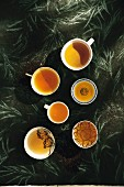 Various cups of black tea