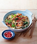 Egg noodles with pork, vegetables and peanut sauce (Asia)