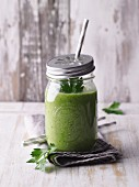 A green avocado smoothie with batavia and wheatgrass powder