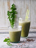 Green dandelion and cos lettuce smoothie with flax seeds and basil