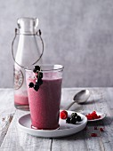 A beetroot smoothie with pomegranate, peach and acai powder