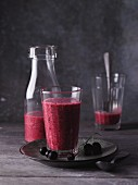 A redcurrant and banana smoothie with coconut oil