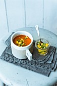 Spicy oven-roasted tomato soup with harissa and mango salsa