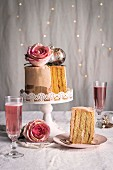 Chiffon cake with roses and sparkling rosė wine for Christmas