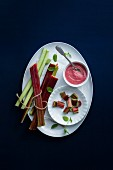 Rhubarb sauce and fresh rhubarb