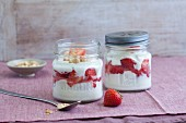 Strawberry and quark desserts with almonds in jars