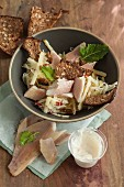 Kohlrabi salad with smoked trout and wholemeal bread