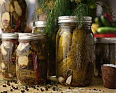 Jars of homemade gherkins with dill and garlic