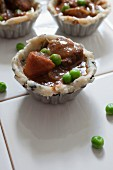 Unbaked mini meat pies