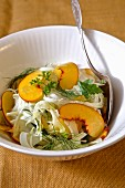 Fennel salad with peach and fennel leaves