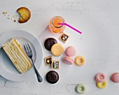 Biscuits, a slice of cake and pink lemonade