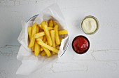 Chips with mayonnaise and ketchup