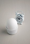 An alarm clock and a boiled egg