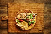 Grilled sea bream with tacos, salsa, salad and limes