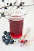 A glass of sloe jelly