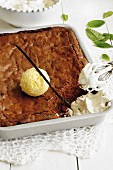 Chocolate brownie with vanilla ice cream and cream