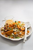 Bulgur and chickpea salad with pumpkin and a physalis dressing