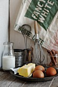 Ingredients for making cake: eggs, milk and butter