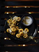 Kesar Peda (Indian milk sweets) with roasted pine nuts and sea salt flakes