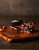 Pieces of almond chocolate on a wooden board