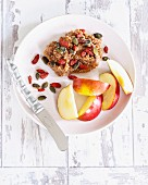 Almond butter with apples, pumpkin seeds and goji berries