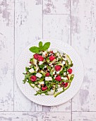 Courgette and feta cheese salad with raspberries (seen from above)