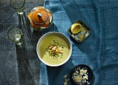 Pea and coconut soup with diced potatoes