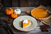 Pumpkin pie on rustic wooden surface