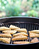 Smoked tofu on a barbecue