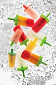 Various ice lollies on ice cubes (seen from above)