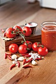 Tomato salsa in a jar with ingredients