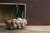 Chicken eggs in a wire basket