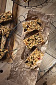 Muesli bars on baking paper on a wire rack (seen above)