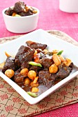 Braised pork cheeks with chickpeas